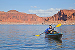 Jacque Miniuk admires the ever-changing geology while paddling on Lake Powell (near mile 117) in the Glen Canyon National Recreation Area, Utah