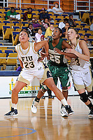 11 November 2011:  FIU's Finda Mansare (23) combines with Zsofia Labady (3) to box out Jacksonville Jane'l Osborne (25) in the first half as the FIU Golden Panthers defeated the Jacksonville University Dolphins, 63-37, at the U.S. Century Bank Arena in Miami, Florida.