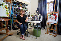 NWA Democrat-Gazette/DAVID GOTTSCHALK   Shawna Elliot sits in her favorite personal space Monday, July 10, 2017, her art studio in her home in Fayetteville. The room was formally her son's until he moved out.