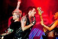 Ashley Dzerigan bass player for Adam Lambert