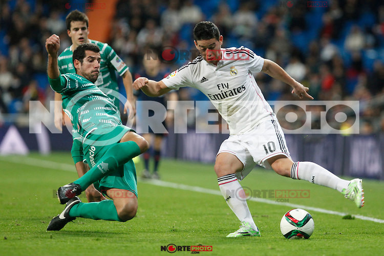 Real Madrid´s James Rodriguez (R) and Cornella´s Pere during Spanish King Cup match between Real Madrid and Cornella at Santiago Bernabeu stadium in Madrid, Spain.December 2, 2014. (NortePhoto/ALTERPHOTOS/Victor Blanco)