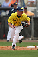 March 21, 2010:  First Baseman Mike Dufek (7)) of the Michigan Wolverines in the field during a game at Tradition Field in St. Lucie, FL.  Photo By Mike Janes/Four Seam Images