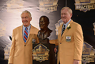 Canton, Ohio - August 8, 2015: Bill Polian, former NFL team executive, poses with Hall of Fame coach Marv Levy and his bust during the 2015 Pro Football Hall of Fame enshrinement in Canton, Ohio, August 8, 2015. During his 32-season career, Polian made contributions to three different NFL teams that resulted in a combined five Super Bowls.(Photo by Don Baxter/Media Images International)