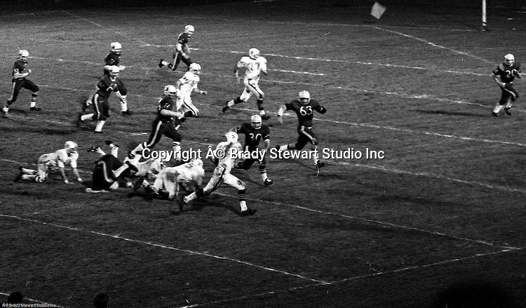 Bethel Park PA:  Offensive play with Clark Miller 30 taking an option pitch and taking it down to the 15 yard line after good blocks by Dennis Franks 66, Joe Barrett 75 and Gary Biro 81.  The offense and defense played very well in the  14-0 victory over Canon McMillan. Others in the photo; Bob Hensler 77.  The defensive unit was one of the best in Bethel Park history only allowing a little over 7 points a game.