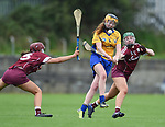 Louise Egan of Clare in action against Caoimhe Garvey and Sarah Spellman of Galway during their Minor A All-Ireland final at Nenagh.  Photograph by John Kelly.