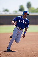 Texas Rangers outfielder Bubba Thompson (4) hustles towards third base during an Instructional League game against the San Diego Padres on September 20, 2017 at Peoria Sports Complex in Peoria, Arizona. (Zachary Lucy/Four Seam Images)