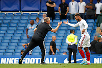 Sheffield United manager, Chris Wilder and Lys Mousset celebrate the result during the Premier League match between Chelsea and Sheff United at Stamford Bridge, London, England on 31 August 2019. Photo by Carlton Myrie / PRiME Media Images.