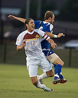 Winthrop University Eagles vs the Brevard College Tornados at Eagle's Field in Rock Hill, SC.  The Eagles beat the Tornados 6-0.  Adam Brundle (12) goes down after a foul by Ryan Vandenberg (6)