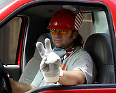 New York City - September 15, 2001 -- A rescue and recovery volunteer displays a sign of peace while driving materials to areas destroyed by the September 11, 2001, terrorist attack on the World Trade Center (WTC) on September 15, 2001. .Credit: Eric J. Tilford - US Navy via CNP