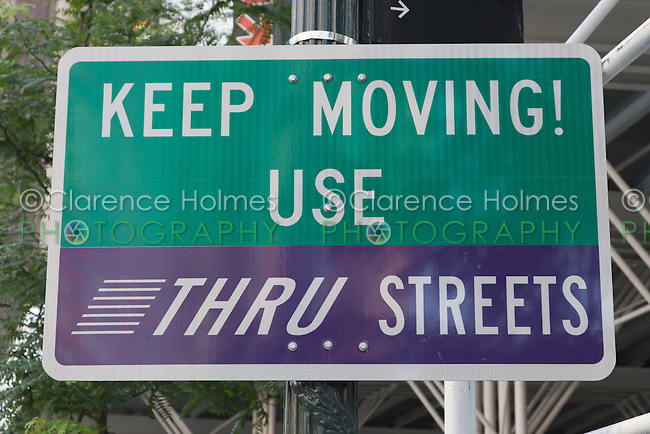 "New York City advance promotional sign encouraging motorists to ""Keep Moving! Use Thru Streets"" as part of the ""Thru Streets"" initiative to improve midtown traffic flow."