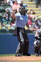 Home plate umpire Alex Ransom makes a call during a game between the Mobile BayBears and Huntsville Stars on April 23, 2014 at Joe Davis Stadium in Huntsville, Tennessee.  Huntsville defeated Mobile 4-1.  (Mike Janes/Four Seam Images)