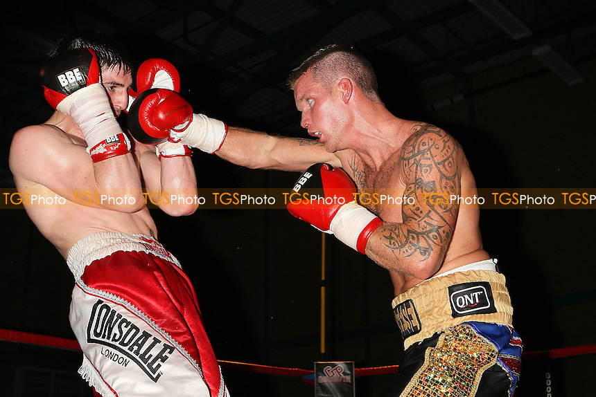 Pat McAleese (black/gold shorts) defeats Fran Gonzalez in a Light-Middleweight boxing contest at Goresbrook Leisure Centre,Dagenham, promoted by Steve Goodwin - 19/03/11 - MANDATORY CREDIT: Gavin Ellis/TGSPHOTO - Self billing applies where appropriate - Tel: 0845 094 6026