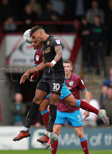 7th October 2017, Glanford Park, Scunthorpe, England; EFL League One football, Scunthorpe versus Wigan; Ivan Toney of Wigan Athletic and Lee Novak of Scunthorpe United compete for a header in the 1-2 win for Wigan