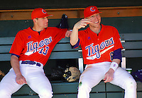 Brad Miller (13) and Stan Widmann (6) talk prior to a game between the Charlotte 49ers and Clemson Tigers Feb. 20, 2009, at Doug Kingsmore Stadium in Clemson, S.C. (Photo by: Tom Priddy/Four Seam Images)
