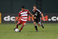 FC Dallas forward David Ferreira (10) shields the ball against DC United Stephen King (20)    FC Dallas defeated DC United 3-1 at RFK Stadium, Saturday August 14, 2010.