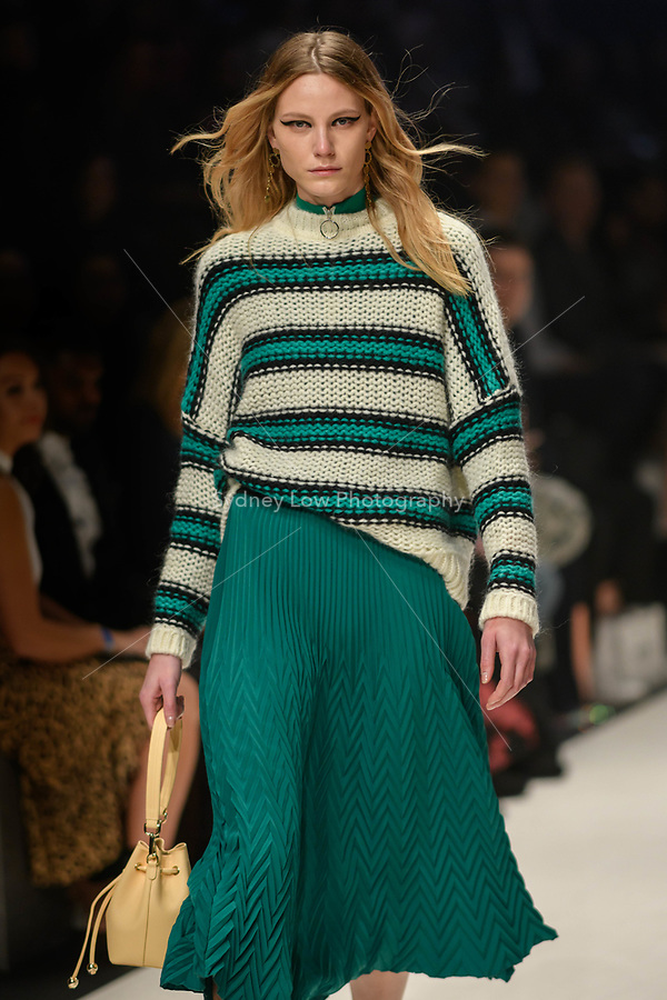 Melbourne, September 7, 2018 - A model wearing clothing from retailer Maje walks at the Town Hall Closing Runway show in Melbourne Fashion Week in Melbourne, Australia. Photo Sydney Low