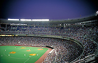 A wide view shows the ball park crowd and playing field of Phillies pro baseball. Philadelphia Phillies. Philadelphia Pennsylvania United States Veteran's Stadium.