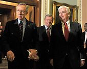 Washington, DC - December 24, 2009 -- United States Senate Majority Leader Harry Reid (Democrat of Nevada), left, U.S. Senator Max Baucus (Democrat of Montana), center, and U.S. Senator Christopher Dodd (Democrat of Connecticut) leave the U.S. Senate Chamber to make remarks to the press after voting to pass H.R. 3590, regarding health care reform in the U.S. Capitol on Thursday, December 24, 2009.  The vote, which was along party lines, was 60 Democrats in favor and 39 Republicans against..Credit: Ron Sachs / CNP.(RESTRICTION: NO New York or New Jersey Newspapers or newspapers within a 75 mile radius of New York City)