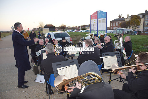 Weekend of events to commemorate 100th anniversary of the German U-Boat fleet surrendering in Harwich, November 1918. Unveiling of willow u-boat, Harwich, Essex with local MP Bernard Jenkin having a go at conducting. Nov 2018