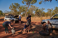 Truck drivers Nick and Joanna Atkins stop on the Gibb River Road to say hello to a local Aboriginal family who are on their way to a funeral south of Kununurra during their journey from Kununurra to Kalumburu.
