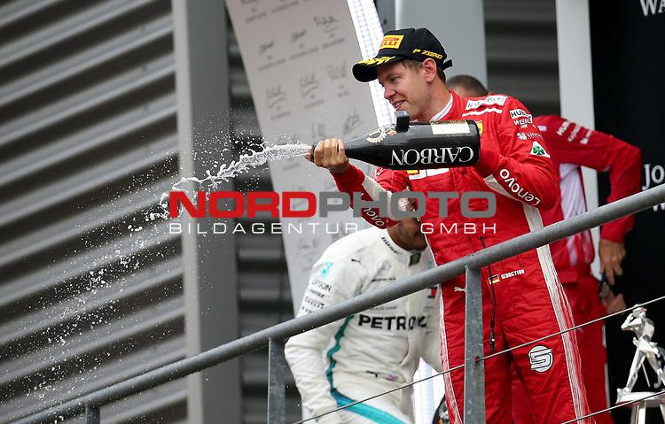 26.08.2018, Circuit de Spa-Francorchamps, Spa-Franchorchamps, FORMULA 1 2018 JOHNNIE WALKER BELGIAN GRAND PRIX, 23. - 26.08.2018<br /> , im Bild<br />Podium:<br />Sieger Sebastian Vettel (GER#5), Scuderia Ferrari, 2.Platz für Lewis Hamilton (GB#44), Mercedes AMG Petronas Formula One Team, 3.Platz für Max Verstappen (NEL#33), Aston Martin Red Bull Racing<br /> <br /> Foto © nordphoto / Bratic