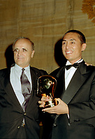 Montreal (Qc) CANADA -August 28,1995 File Photo -<br /> Chinese film maker Zhang Ymou (R) receive an achievement award from Serge Losique, World Film Festival President.<br /> <br /> <br /> <br /> <br /> photo (c) Pierre Roussel - Images Distribution