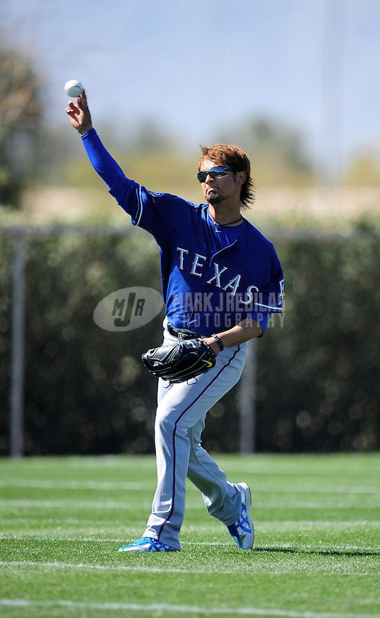 Mar. 1, 2012; Surprise, AZ, USA; Texas Rangers pitcher Yu Darvish during spring training workouts at the practice fields at Surprise Stadium.  Mandatory Credit: Mark J. Rebilas-.
