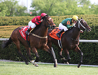 Perfect Officer and Javier Castellano win the 16th running of the Shakertown Grade 2 $100,000.  April 14, 2012.