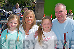 SUNSHINE: Miriam, Sheila, Fiona and Liam Fell, Firies, soaking up the sunshine at Fleadh Cheoil Chiarrai in Milltown last Sunday. .
