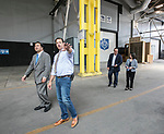 John Corba, assistant director of DePaul Cinespace Studios, walks with A. Gabriel Esteban, Ph.D., president of DePaul, as his wife Josephine, talks with Alex Pissios, president of Cinespace Chicago, during their tour of the school's studios and classroom facilities Tuesday, Aug. 1, 2017, at the Cinespace Chicago Film Studios. (DePaul University/Jamie Moncrief)