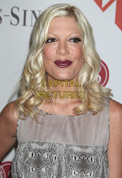 Tori Spelling .At the 84th Annual Helping Hand of Los Angeles, Cedars-Sinai Mother's Day Lunch held at the Beverly Hills Hotel, Beverly Hills, California, USA, 10th May 2013..portrait headshot red lipstick black eyeliner makeup .CAP/ADM/RE.©Russ Elliot/AdMedia/Capital Pictures