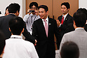 August 26, 2011, Tokyo, Japan - Japans former Foreign Minister Seiji Maehara, center, shakes hands with his fellow Democrat lawmakers in pep rally in Tokyo immediately after Prime Minister Naoto Kan announced his resignation on Friday, August 26, 2011. Kans departure will pave the way for the ruling Democratic Party of Japan to select his successor in a race among seven mediocre candidates slated for August 29. Maehara is favored in the election for the party leadership and that of the country - sixth in five years. (Photo by AFLO)