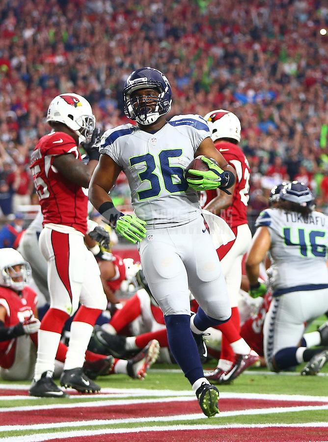 Jan 3, 2016; Glendale, AZ, USA; Seattle Seahawks running back Bryce Brown (36) scores a touchdown against the Arizona Cardinals at University of Phoenix Stadium. Mandatory Credit: Mark J. Rebilas-USA TODAY Sports
