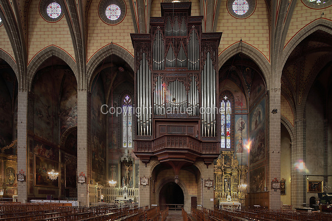 Grand Organ, 14th century, in the nave of Perpignan Cathedral, Perpignan, Pyrenees-Orientales, France. The organ pipes were made by Aristide Cavaille-Coll in 1854-57 and the organ was renovated by Maurice Puget in 1929-30 and again restored 1989-93 by Jean Renaud of Nantes. The Cathedral Basilica of Saint John the Baptist of Perpignan, or Basilique-Cathedrale de Saint-Jean-Baptiste de Perpignan was begun in 1324 by King Sancho of Majorca in Catalan Gothic style, and later finished in the 15th century. The cathedral is listed as a national monument of France, and the organ itself as a monument historique. Picture by Manuel Cohen