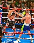 Canelo  Alvarez  (R) Guadalajara, Mex. defeats Sergey, Kovalev (L) Chelyabinsk, Rus in the 11th round WBO Heavyweight Title