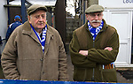 Two elderly Glossop North End supporters waiting for the teams to come out  before their club's game with Barnoldswick Town in the Vodkat North West Counties League premier division at the Surrey Street ground. The visitors won the match by one goal to nil watched by a crowd of 203 spectators. Glossop North End celebrated their 125th anniversary in 2011 and were once members of the Football League in England, spending one season in the top division in 1899-00.