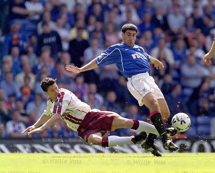 Thomas Flogel of Hearts tackles Claudio Reyna,  April 2000