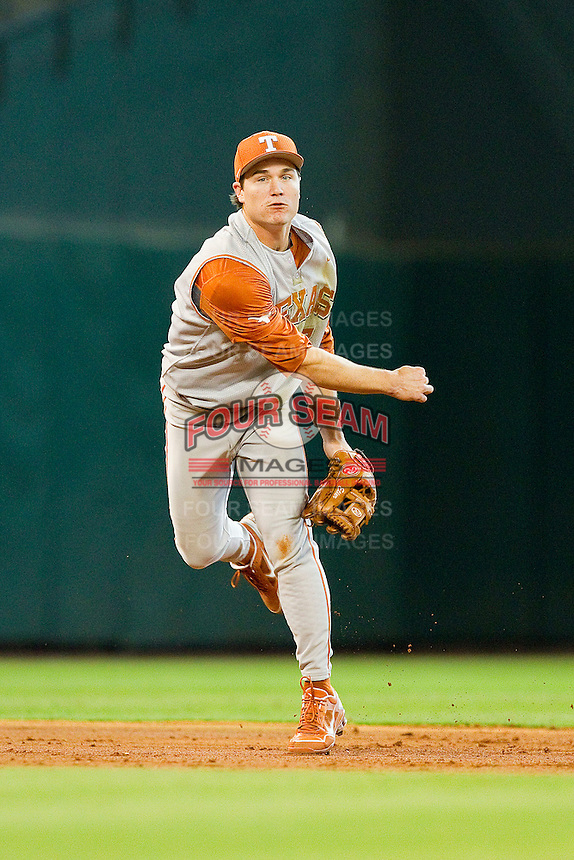Texas Longhorns shortstop Jordan Etier #7 makes a throw to first base against the Tennessee Volunteers at Minute Maid Park on March 3, 2012 in Houston, Texas.  The Volunteers defeated the Longhorns 5-4.  (Brian Westerholt/Four Seam Images)