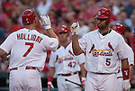 June 18, 2010       St. Louis Cardinals left fielder Matt Holliday (7) is congratulated by St. Louis Cardinals first baseman Albert Pujols (5) as he crosses home plate after hitting a home run in the first inning which also scored teammate Skip Schumaker.  The St. Louis Cardinals defeated the Oakland Athletics 6-4 in the first game of a three-game homestand at Busch Stadium in downtown St. Louis, MO on Friday June 18, 2010.
