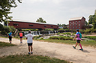August 16, 2017; Pilgrims reach their final destination at the Bridgeton Covered Bridge for day 3 of the ND Trail in Bridgeton, Indiana. They biked 23.2 miles and walked 7.8 from Pimento to Bridgeton. As part of the University's 175th anniversary celebration, the Notre Dame Trail will commemorate Father Sorin and the Holy Cross Brothers' journey. A small group of pilgrims will make the entire 300+ mile journey from Vincennes to Notre Dame over  two weeks.(Photo by Barbara Johnston/University of Notre Dame)