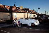 SCOTTSDALE, ARIZONA, USA, 10/2016<br /> Man and young boy sitting by their vintage car on display during the weekly car show by the shopping mall. Owners of various cars come here to show off .<br /> (Photo by Piotr Malecki / Napo Images)<br /> <br /> SCOTTSDALE, ARIZONA, USA, 10/2016<br /> Mezczyzna i chlopiec siedza przy swoim starym samochodzie podczas cotygodniowego pokazu aut na parkingu przy centrum handlowym. Wlasciciele przeroznych samochodow przyjezdzaja tutaj by sie nimi pochwalic.<br /> Fot: Piotr Malecki / Napo Images<br /> <br /> <br />  ###ZDJECIE MOZE BYC UZYTE W KONTEKSCIE NIEOBRAZAJACYM OSOB PRZEDSTAWIONYCH NA FOTOGRAFII###