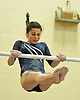 Melanie Golubon of Plainview JFK performs on the uneven bars during a Nassau County varsity gymnastics meet against Massapequa at McKenna Elementary School on Monday, Feb. 1, 2016.