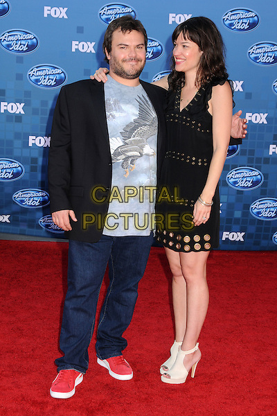 "JACK BLACK & TANYA HADEN .""American Idol 2011"" Finale - Arrivals held at Nokia Theatre LA Live, Los Angeles, California, USA..May 25th, 2011.full length black dress grey gray top married husband wife eagle bird print hoops circles cut out stubble facial hair  red trainers sneakers profile .CAP/ADM/BP.©Byron Purvis/AdMedia/Capital Pictures."