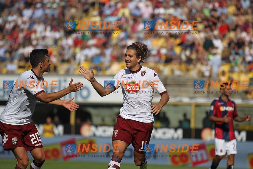 Alessio Cerci di Torino (r) celebrates his penalty goal with Giuseppe Vives, versus Bologna<br /> <br /> Stadio Dall`Ara, Bologna<br /> September 22, 2013<br /> Football Calcio 2013/2014 Serie A<br /> Bologna Torino<br /> Foto C&eacute;zaro De Luca Insidefoto