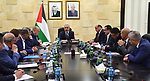 Palestinian Prime Minister Mohammad Ishtayeh, signs an agreement ending the Jerusalem electricity crisis, in the West Bank city of Ramallah, on December 29, 2019. Photo by Prime Minister Office
