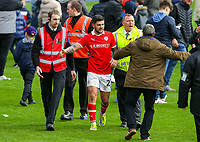 Barnsley's Alex Mowatt is escorted from the pitch after the match<br /> <br /> Photographer Alex Dodd/CameraSport<br /> <br /> The EFL Sky Bet League One - Barnsley v Blackpool - Saturday 27th April 2019 - Oakwell - Barnsley<br /> <br /> World Copyright © 2019 CameraSport. All rights reserved. 43 Linden Ave. Countesthorpe. Leicester. England. LE8 5PG - Tel: +44 (0) 116 277 4147 - admin@camerasport.com - www.camerasport.com