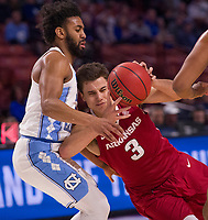 NWA Democrat-Gazette/J.T. WAMPLER Arkansas guard Dusty Hannahs crashes into North Carolina's Joel Berry II Sunday March 19, 2017 during the second round of the NCAA Tournament at the Bon Secours Wellness Arena in Greenville, South Carolina.