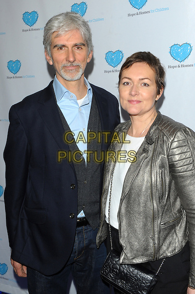 LONDON, UK - MARCH 03 - Damon Hill &amp; Wife attends a screening of 'A Home for Mirela' a documentary about Romanian orphans by Natalie Pinkham at Vue West End on March 3, 2014 in London, England.<br /> CAP/CJ<br /> &copy;Chris Joseph/Capital Pictures