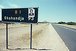A road sign  put  up by the racist  group the 'Wit Wolves'  threatening to kill the new  president Nujoma in Namibia  in Northern Namibia. Africa