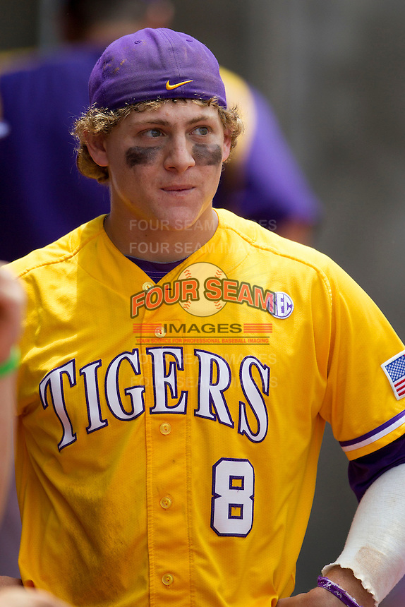 LSU Tigers first baseman Mason Katz (8) in the dugout against the Texas A&M Aggies in the NCAA Southeastern Conference baseball game on May 11, 2013 at Blue Bell Park in College Station, Texas. LSU defeated Texas A&M 2-1 in extra innings to capture the SEC West Championship. (Andrew Woolley/Four Seam Images).